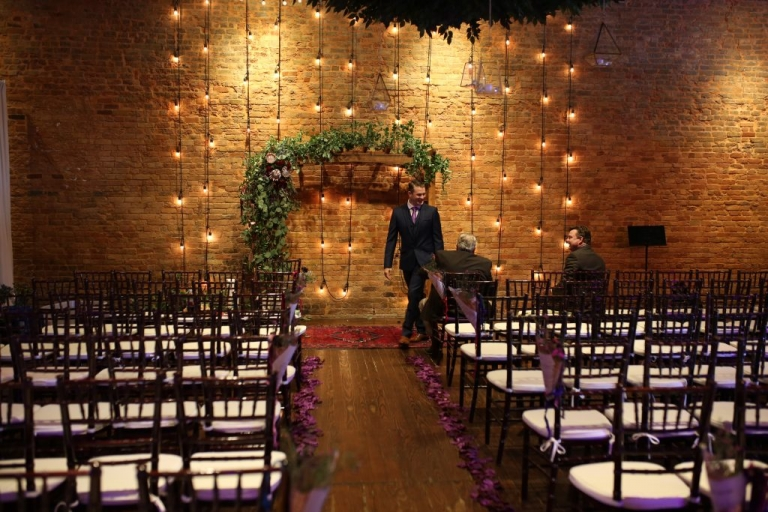 brick wedding ceremony string lights