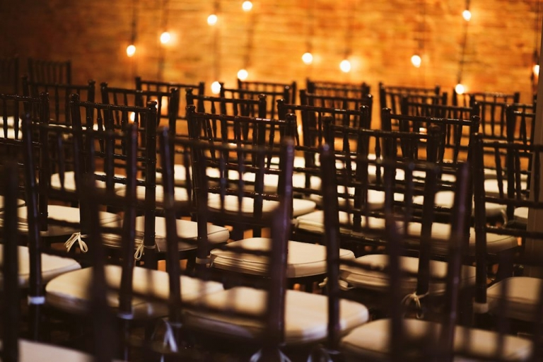 chiavari chairs and brick wall stirng lights